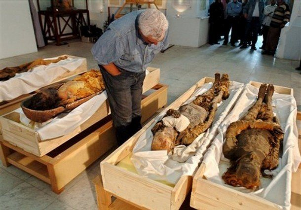 This recent, undated photo released Wednesday June 27, 2007 by Discovery Channel shows  Egypt's antiquities chief Zahi Hawass checking the mummy of Pharaoh Queen Hatshepsut, second right, at the Egyptian museum in Cairo, Egypt.  Egyptian authorities using DNA from a tooth identified Wednesday a mummy found a century ago as the remains of pharaoh Queen Hatshepsut. The mummy was discovered in Egypt's Valley of the Kings burial ground in 1903, but had not been identified as that of the queen and was left on site until two months ago when it was brought to the Cairo Museum for testing, said Egypt's antiquities chief Zahi Hawass. From AP Photo by Brando Quilici.